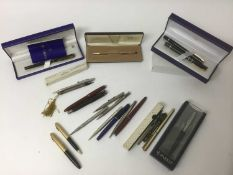 Collection of pens and silver propelling pencils