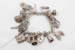 Silver charm bracelet with sixteen silver charms