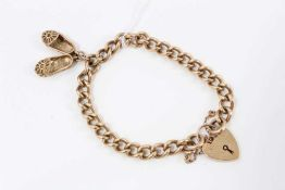 9ct gold bracelet charm, hung with shoe charms, with padlock clasp total weight 26g
