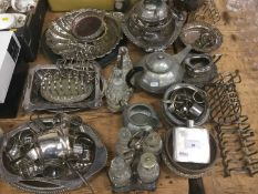 Large collection of silver plate to include cutlery, baskets, wine coasters, napkin rings and other