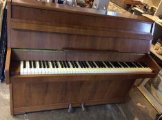 Good quality Kemble iron farmed upright over strung piano in walnut case, supplied by Harrods