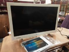 Sony Bravia flatscreen television model number KDL-24EX320, with manual and remote control