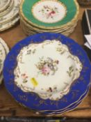 Seventeen Victorian porcelain dessert plates with polychrome painted floral decoration on green grou