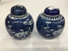 Pair of Chinese blue and white porcelain prunus ginger jars and covers