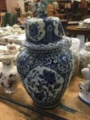 Large Delft pottery blue and white vase and cover and two Chinese porcelain ginger jars