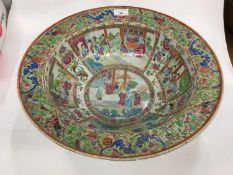 19th century Cantonese famille rose basin decorated with panels depicting figures, riveted, 42cm dia