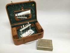 Shagreen cigarette box, pig skin covered travelling case and a manicure set