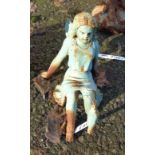 A painted cast iron garden seated fairy