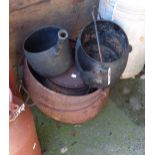 Four cast iron saucepans, one with lid