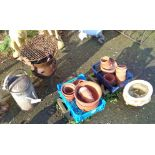 Two boxes of plant pots, barbecue, watering can, etc.
