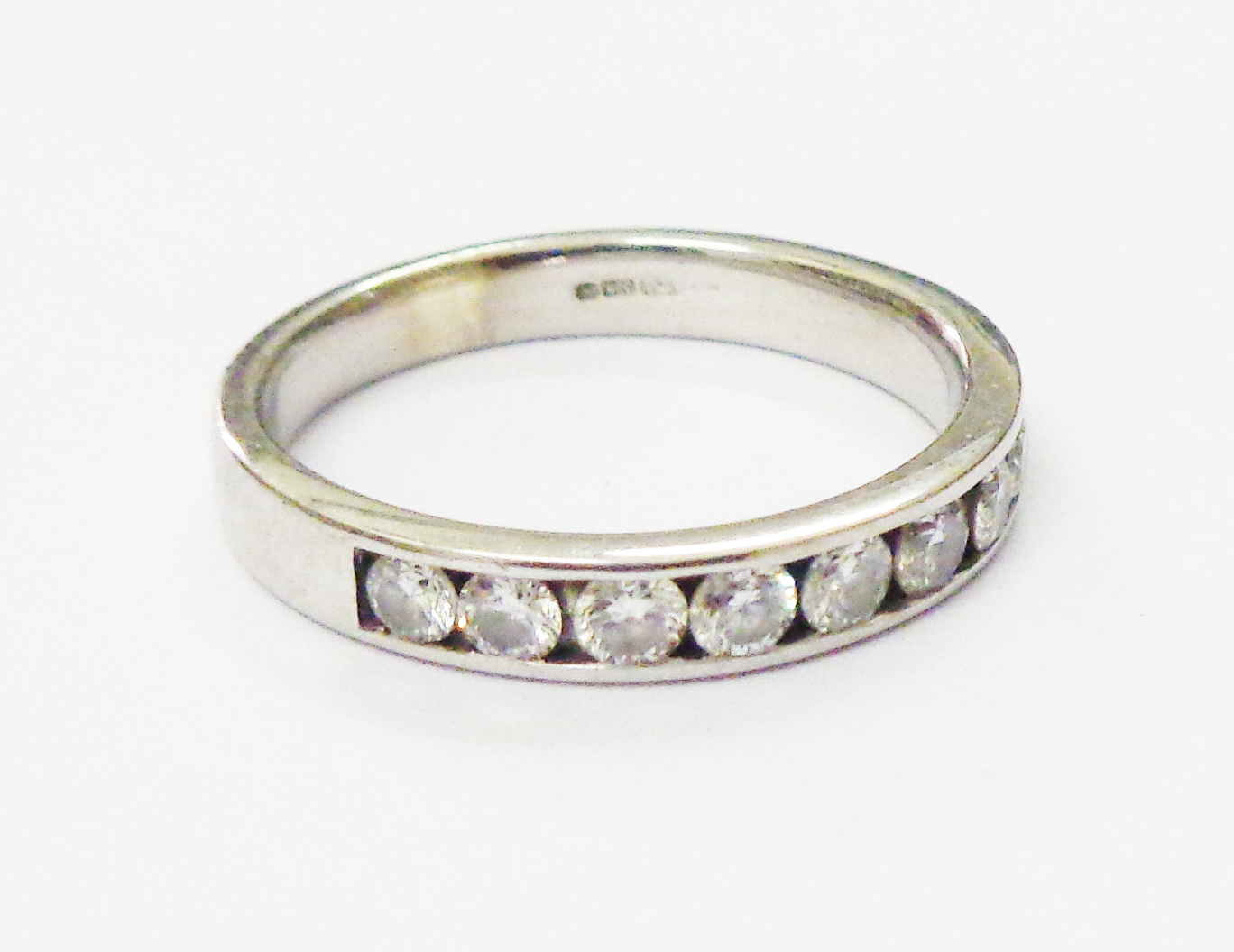Lot 1403 - An import marked 375 white gold and diamond set half eternity ring by Canadian Ice, complete with