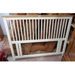 """A 4' 6"""" headboard with natural finish to top rail and painted slat back"""