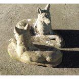 A pair of concrete garden dogs