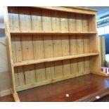 "A 4' 6"" old waxed pine two shelf plate rack"
