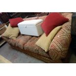 """An 8' 8"""" modern Chesterfield two section settee upholstered in repeat pattern tapestry, with six"""
