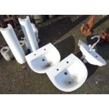 Four sinks including two pedestals and one vintage corner