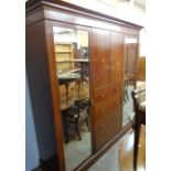 """A 6' 11"""" Victorian quarter veneered and strung walnut triple compactum wardrobe with moulded"""