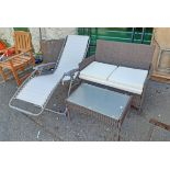 A modern patio table and two seat settee - sold with a modern folding lounger