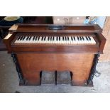 A late 19th Century E. Francis of Carno (Montgomeryshire) stained mixed wood cased harmonium with