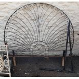 A wrought iron garden divider - sold with a metal sign bracket