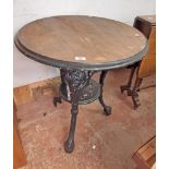 A pub table with cast iron base