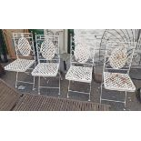 A set of four painted metal garden chairs