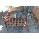 Assorted metalware including cast iron fire grate, skillet, kettle, outside lamp, etc.