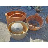 A cast iron pan, glue pot, etc.