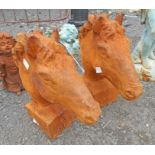 A pair of cast iron horse heads