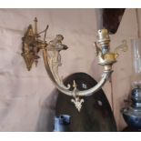 A pair of gothic revival gilt brass wall sconces
