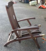 A teak steamer chair with cover
