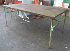 A large metal potting table