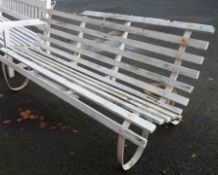 A 1.8m old painted wrought iron framed garden bench with wooden slats - some a/f