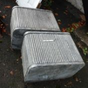 A large pair of modern galvanized planters