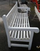 A 1.83m painted wood slat back garden bench, set on square supports