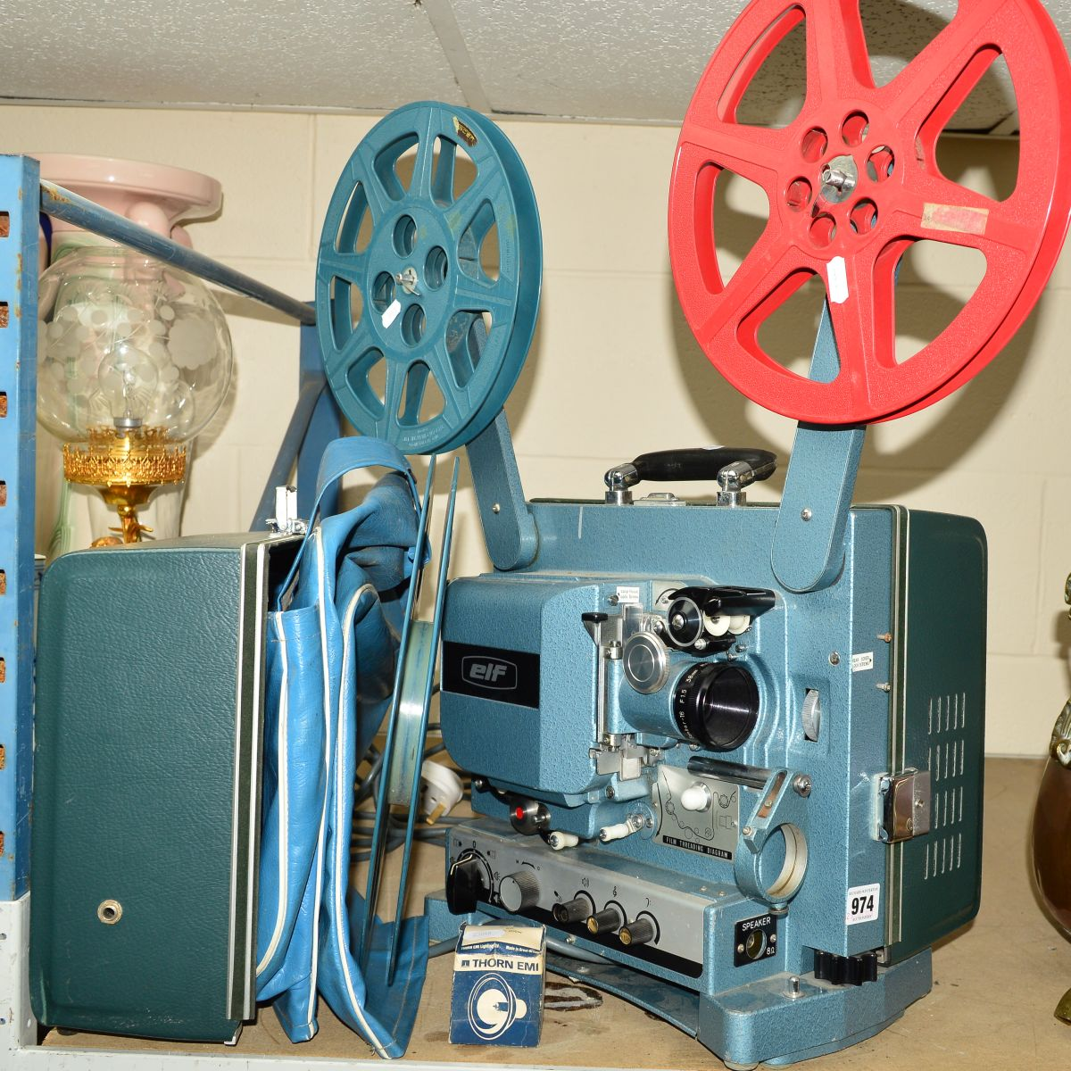 Lot 974 - A CASED ELF CINE PROJECTOR, with spare reels