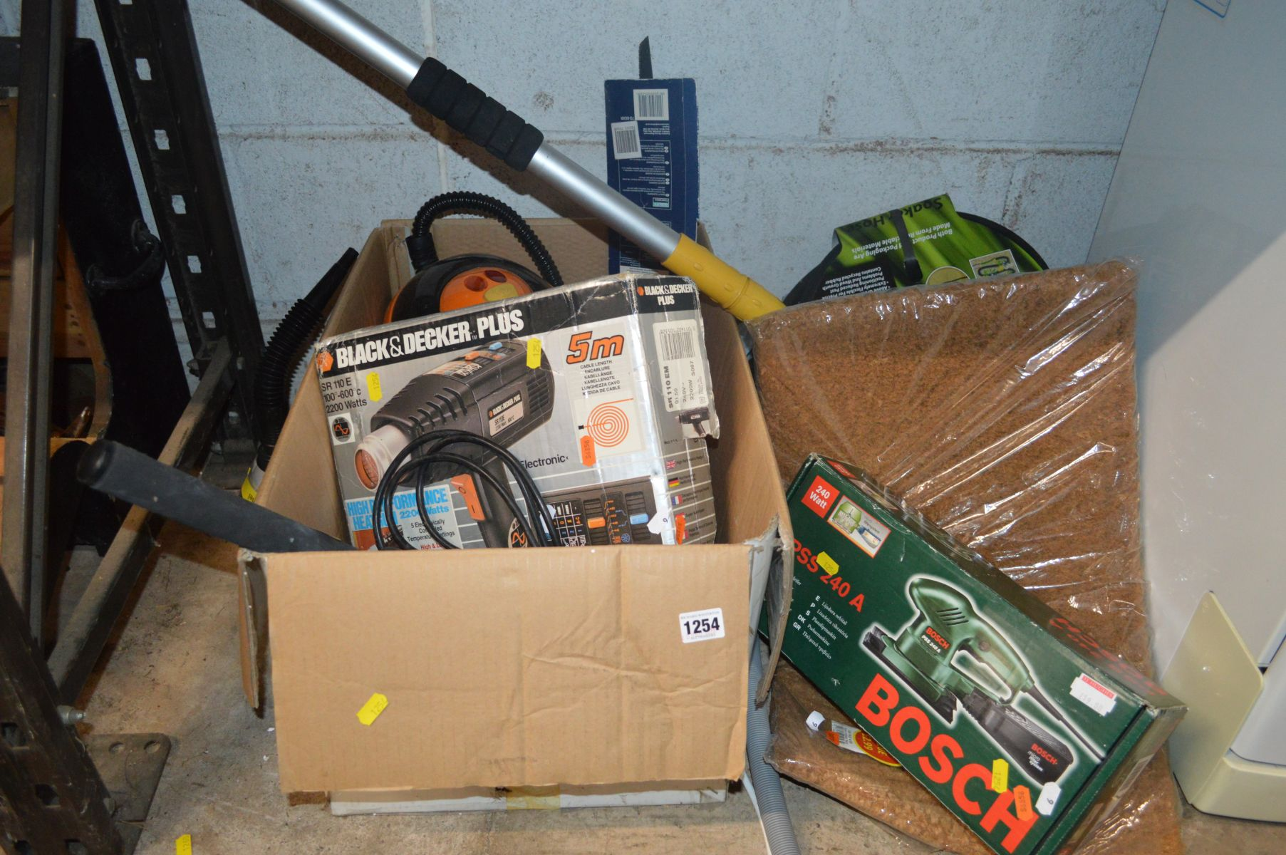 Lot 1254 - A BOXED BOSCH PSS 240 A ORBITAL SANDER together with a Black and Decker heat gun, Steam Easy Pro