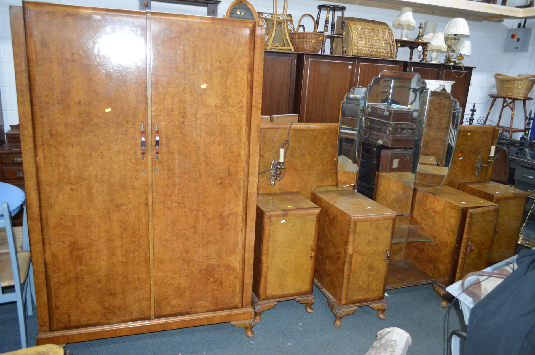 Lot 1413 - AN EARLY TO MID 20TH CENTURY ART DECO WALNUT FOUR PIECE BEDROOM SUITE, comprising a triple door