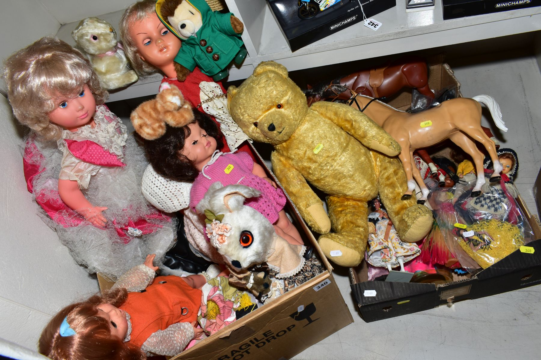 Lot 340 - TWO BOXES AND LOOSE OF DOLLS, TOYS AND SOFT TOYS, including a wood straw filled growler bear