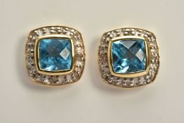 A PAIR OF TOPAZ AND DIAMOND EARRINGS, each yellow metal earring set with a cushion cut blue topaz