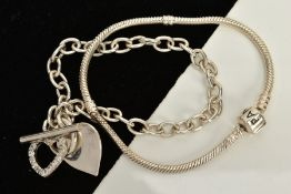 A PANDORA CHARM BRACELET AND SILVER CHARM BRACELET, the snake chain fitted with a charm clasp signed