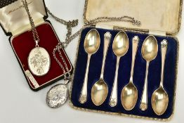 A CASED SET OF SILVER GOLFING TEASPOONS AND TWO LOCKETS, the teaspoons with golfing design to the