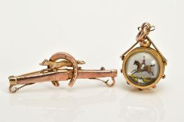 A 9CT GOLD ESSEX CRYSTAL PENDANT AND BROOCH, the double sided compass pendant depicting a hunt