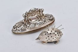 A SILVER PIN CUSHION AND NAIL BUFFER, the pin cushion on the form of a hedgehog, hallmarked