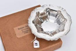 A BARBARA CATTLE SILVER DISH, the bowl of openwork panels and scroll design, with a wavey detailed