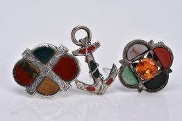 THREE SCOTTISH HARDSTONE BROOCHES, the first designed with a central circular cut orange stone