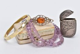 A SELECTION OF ITEMS, to include a foliate engraved silver vesta, with striker to the base,