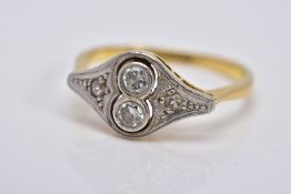 AN EARLY 20TH CENTURY DIAMOND RING, of art deco style, set with two central round brilliant cut