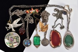 A SELECTION OF JEWELLERY, to include five white metal pendants necklaces, such as an agate slice