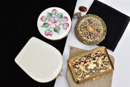 FOUR COMPACTS, to include a circular compact with white guilloche and floral enamel, a white shell